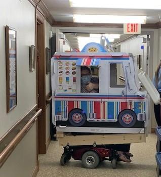Administrator delivers ice cream in custom-made ice cream truck