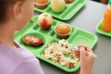 Student meal tray with food.