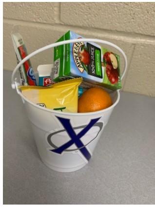 Breakfast Bucket filled with breakfast food.