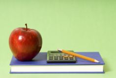 School nutrition finances, calculator, book, pencil, apple