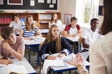 Students listen to a teacher