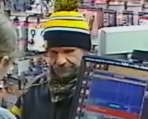 A surveillance iamge following an armed robbery at Romantix, 315 Kirkwood Ave