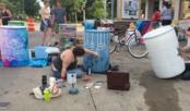 Painting rain barrels