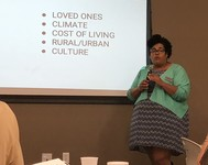 A speaker at the LGBTQ Older Adults Conference is shown.