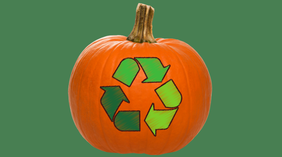An orange pumpkin with a recycling logo on it.