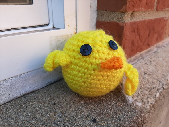 A crocheted duck is shown.