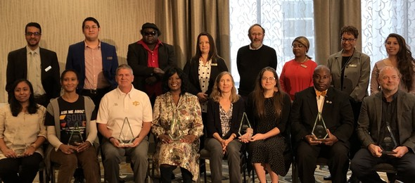 Award winners and Human Rights Commission members pose at the Human Rights Awards Breakfast