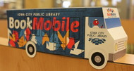 model bookmobile on shelf