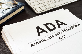 """A paper with """"ADA: American's with Disabilities Act"""" printed on it is shown."""