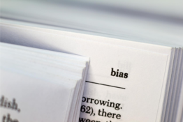 """A dictionary open to the word """"bias"""" is shown."""