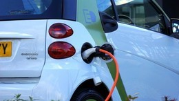 Electric vehicle being charged