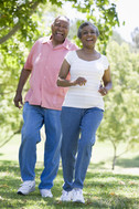 Older couple walking on trail