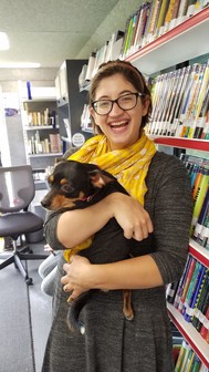 Shawna with a dog on the Bookmobile