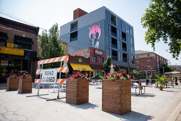 The outdoor seating space on North Linn Street is shown.