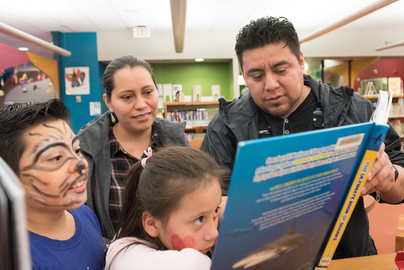 latino family reading together
