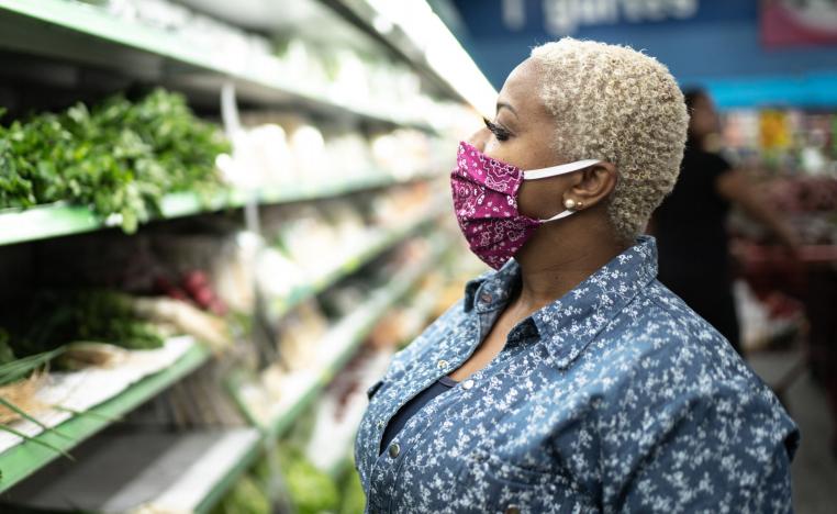 Grocery shopper wearing a mask