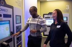 BMV staff check out a BMV Service Kiosk