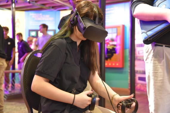 A high school student exploring a virtual reality demonstration in the Normandy Barn.