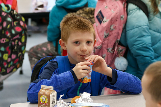 A student at Peaks Mill Elementary School (Franklin County) eats lunch in the school cafeteria in early March.