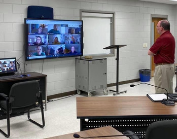 New Garrard County Superintendent Kevin Stull is pictured in a classroom talking to teachers on a videoconference call.