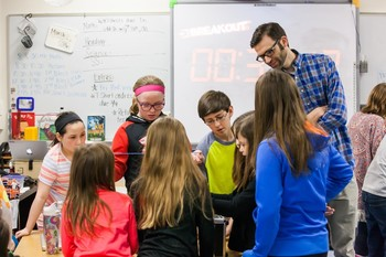 Donnie Piercey works with his students on a project in a classroom.