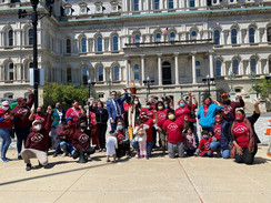 Photo of Mayor Young & CASA in front of City Hall