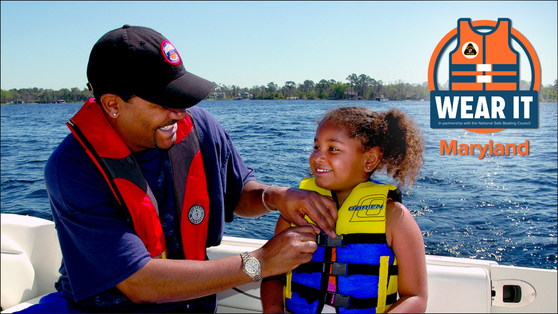 Photo of father and child putting on lifejackets