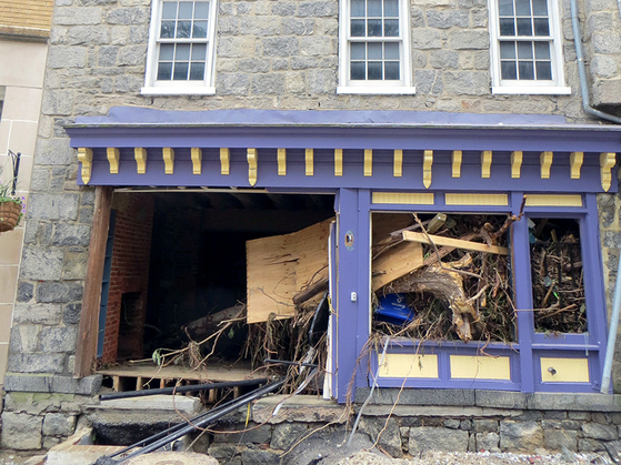 Photo of storefront damaged by devestating floods in Ellicott City