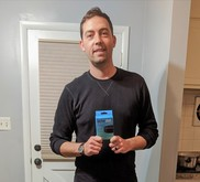 Photo of man holding smart speaker box