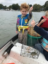 Kid with crab