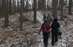 Photo  of hikers on snowy trail