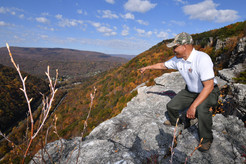 Photo of Lt. Governor Rutherford posing on Will's Mountain in the fall