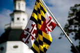 Maryland flag with state house dome in background