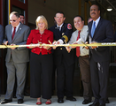 Nancy Floreen, Ike Leggett and three others cutting a ribbon at the Glenmont Fire Station.