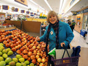 Nancy Floreen shopping for apples.