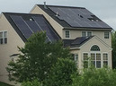 back of a single-family house with solar panels on the roof