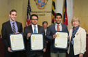 David Rekhtman, Sambuddha Chattopadhyay and Rohan Dalvi receiving proclamations from Nancy Floreen