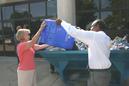Nancy Floreen and Ike Leggett dumping a recycling box