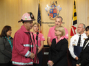 Nancy Floreen presenting a proclamation for Breast Cancer Awareness Month in Council Session