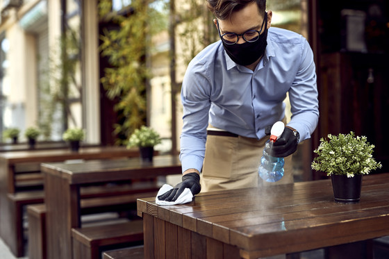 waiter cleaning table
