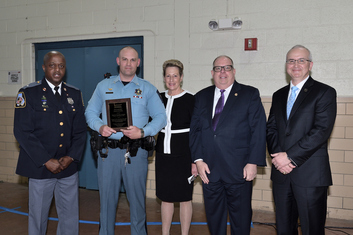 Image Governor Hogan and State Superintendent Dr. Salmon honor Blain Gaskill, School Resources Officer of Great Mills HS