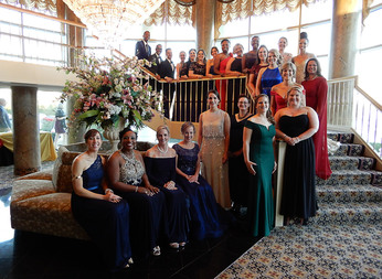 Group photo of all 24 Maryland Teachers of the Year standing on stair case at Gala venue