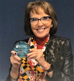 Image of Susan holding Award
