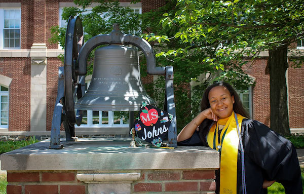 Photo courtesy of Savannah Class Photography. Veronica Johns, with grad cap, at McDaniel College.