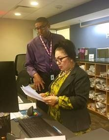 DPIE Permits Center Supervisor Demetrius Jones (left) and Liliana Escobar stand ready to help visitors in need of assistance.
