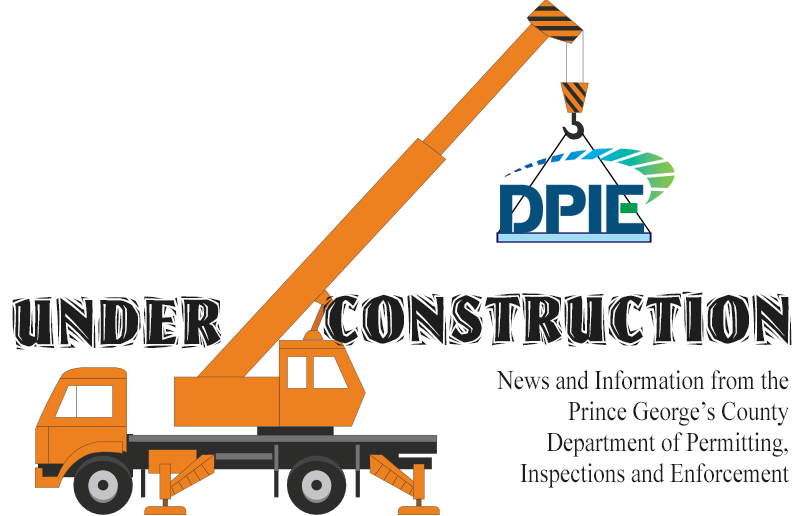 DPIE Under Construction Masthead, boom crane with DPIE logo over words Under Construction.