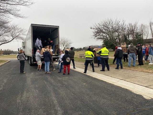 Crownsville Veterans Cemetery Volunteers unload trucks