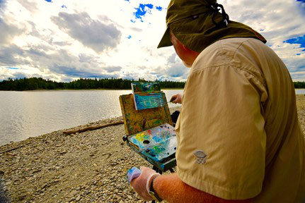 Michael Vermette, visiting artist, painting along the Allagash Wilderness Waterway. Photo by Troy Sands.