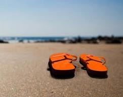 orange flip flops on the beach