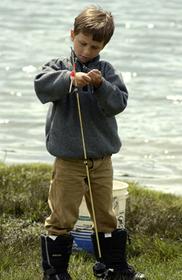 Boy standing on shore